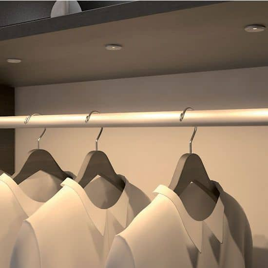 Recessed puck light for closet with rails and hangers