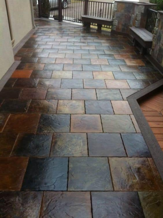 multi-coloured stone flooring for outdoor with stone boundary and entry gate