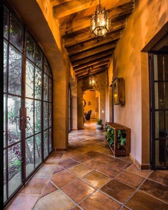 stone flooring for hallway with wooden roof and glass doors