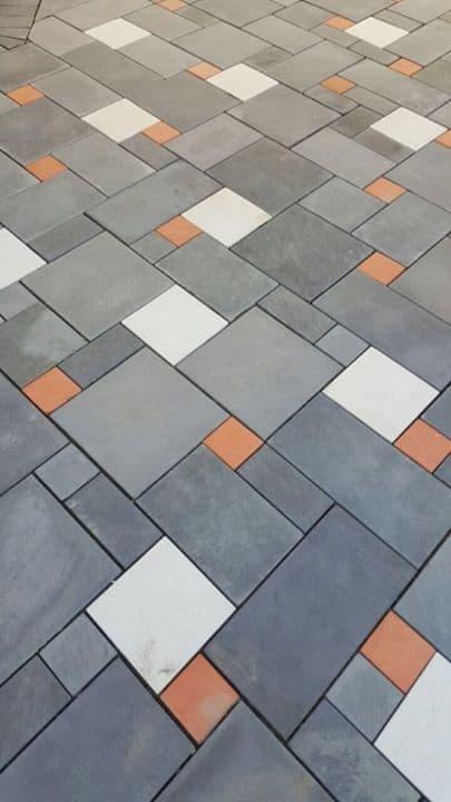 muli-coloured stone flooring with white, grey and orange flooring