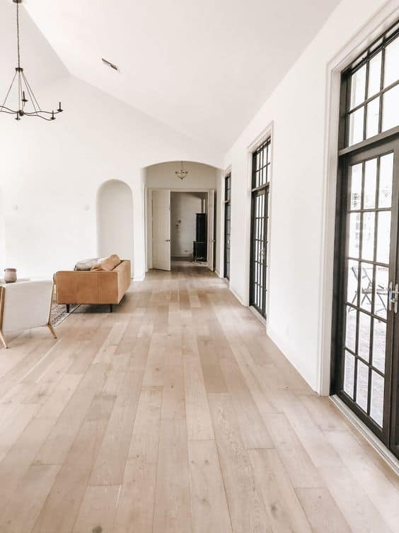light colour vinyl tile for a subtle living room with white walls and ceiling