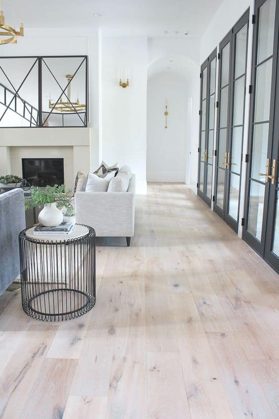 light coloured vinyl tiles for living room with glass doors and windows