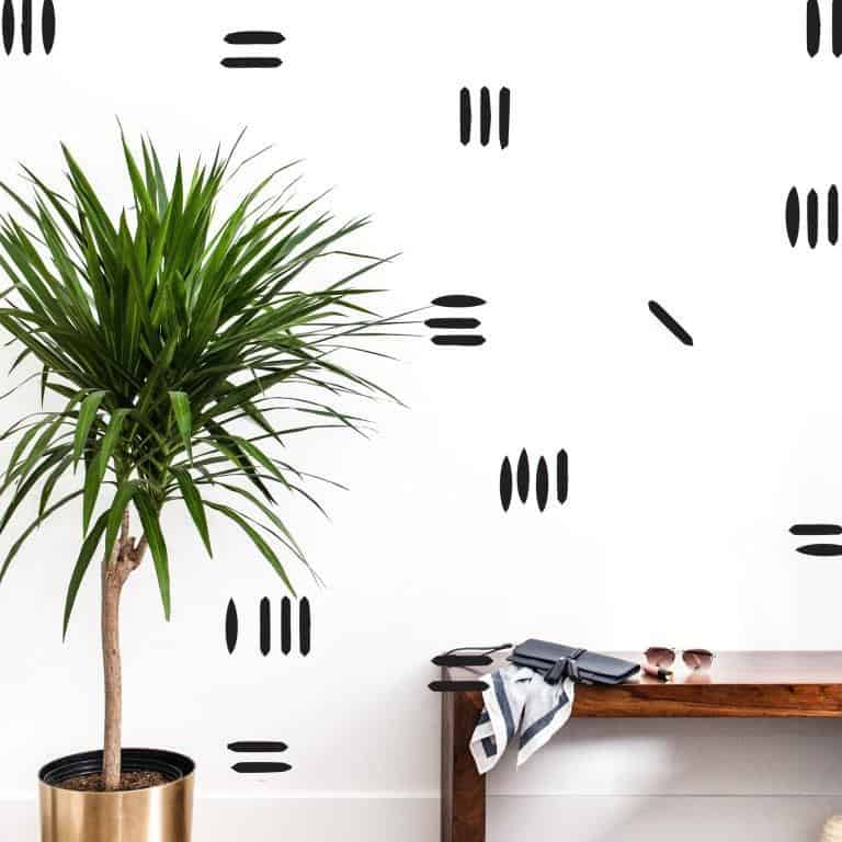 a white wall with black wonky stripes