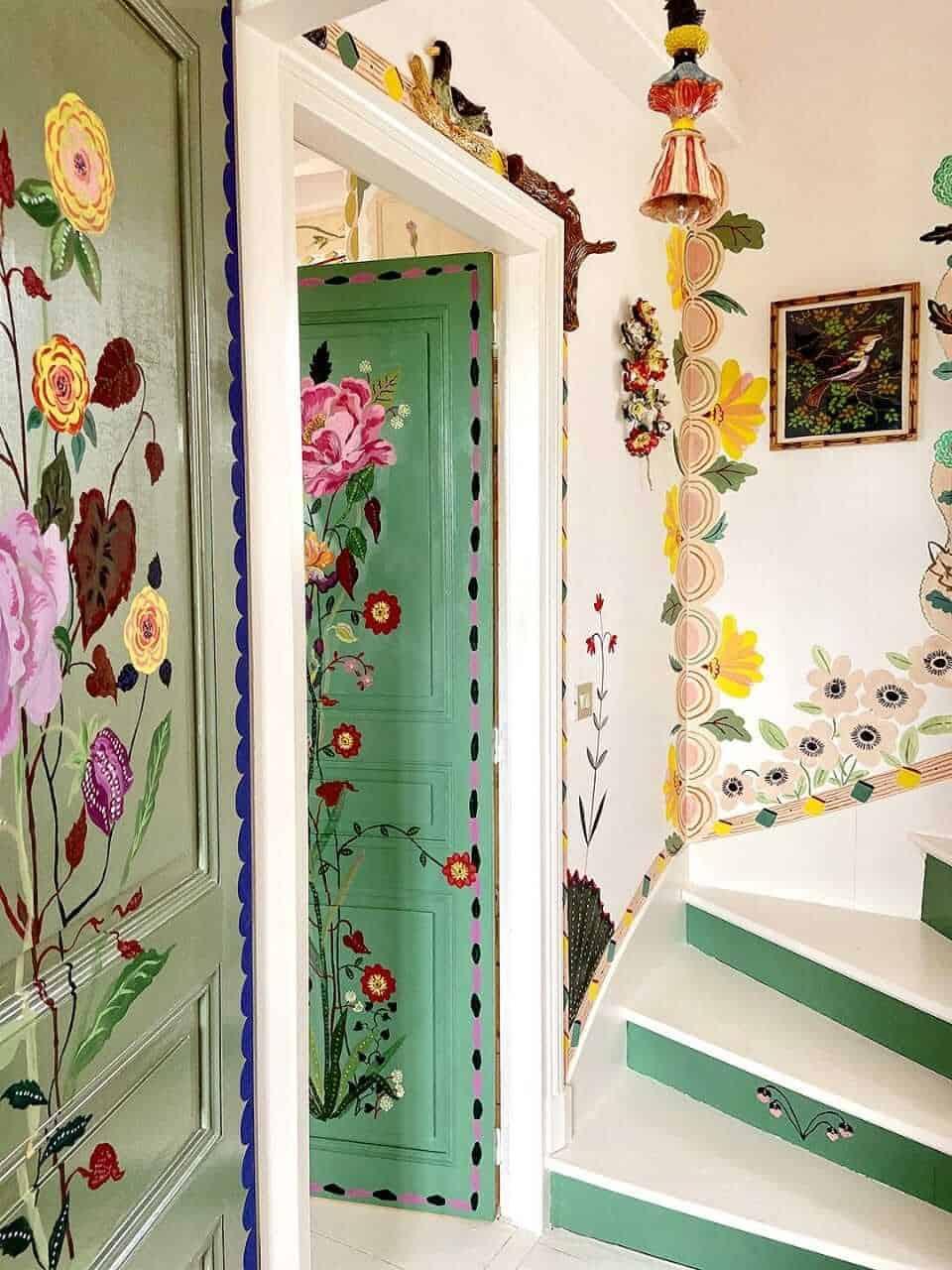 green solid door wih hand-painted flowers, living room door designs