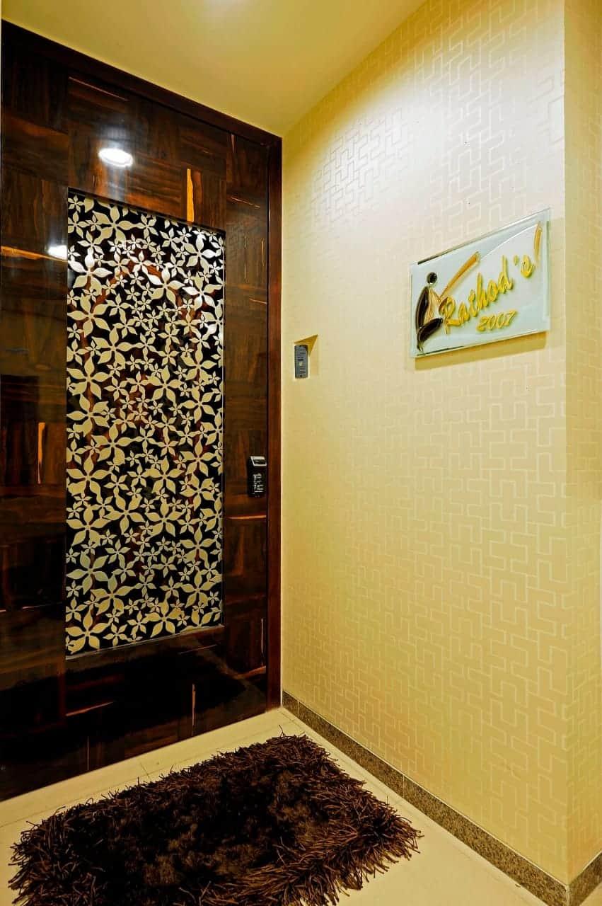 dark brown jali door design with laser cut panel in center