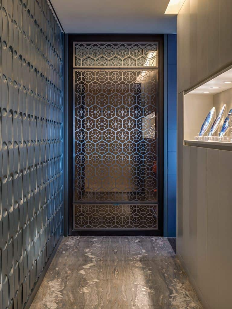 jaali door design that doubles up as a partition wall design