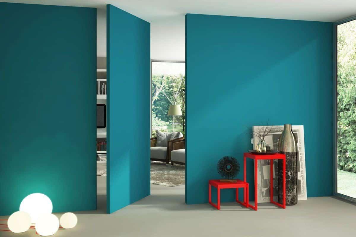 big blue pivoting door; living room door designs