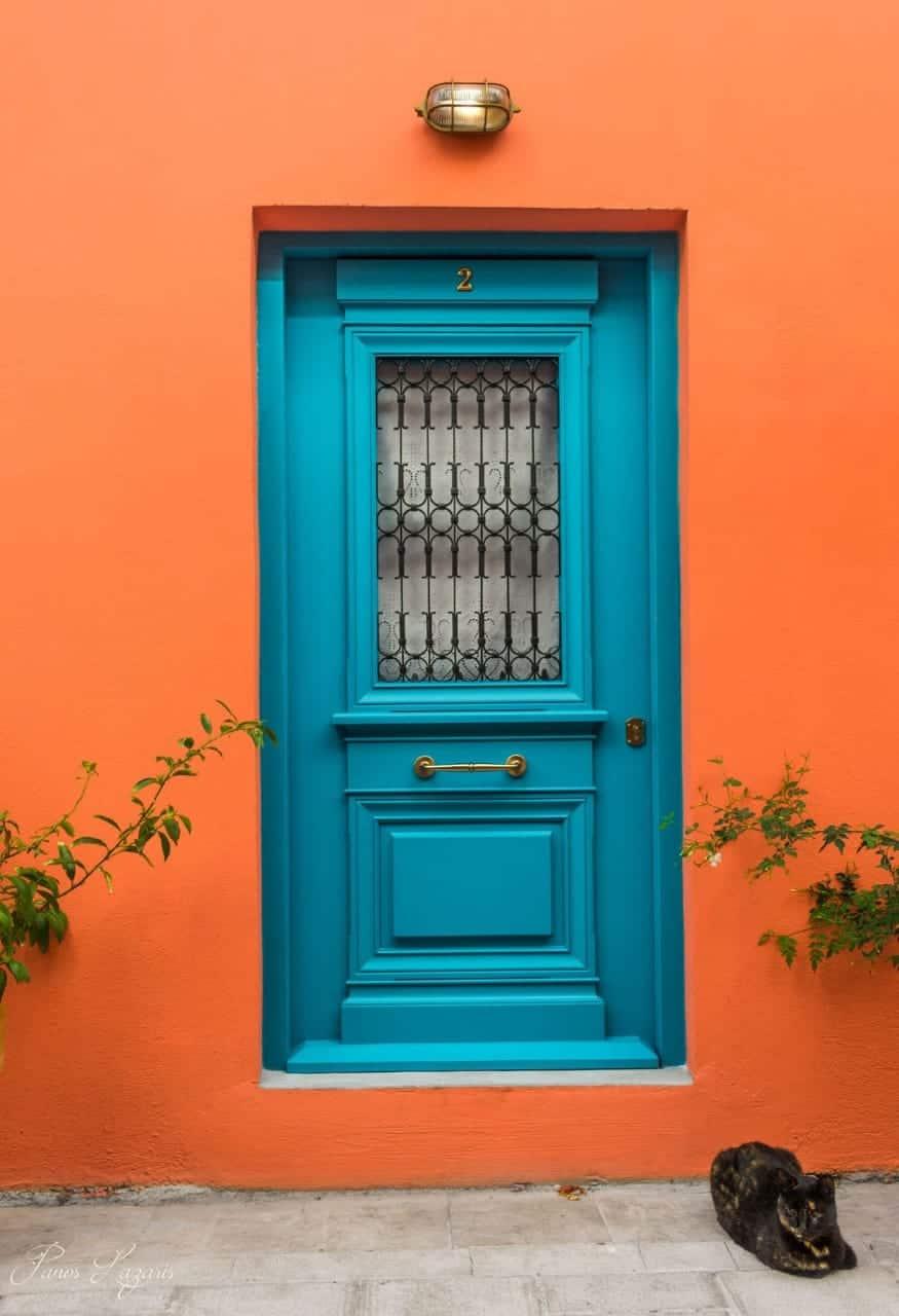 turquoise door on an orange wall, room door designs with window