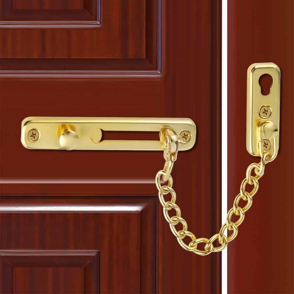 golden chain door lock on brown door