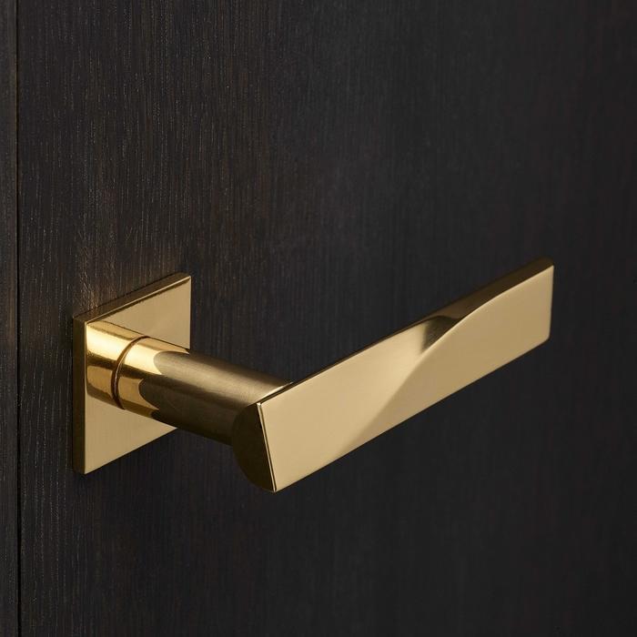 golden lever handle lock on square rose