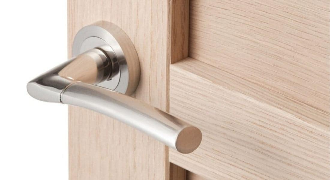 silver lever handle door lock on round rose