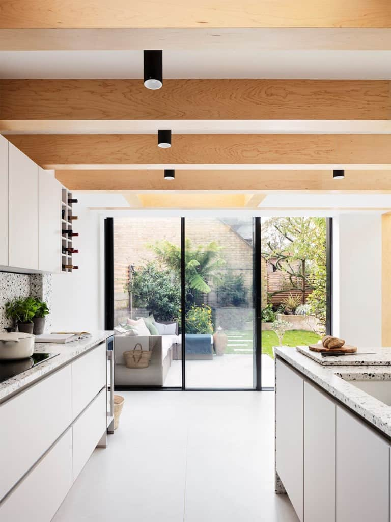 home design interior with sliding glass window with black metal frame, kitchen design, home design interior with wooden ceiling and accent lighting
