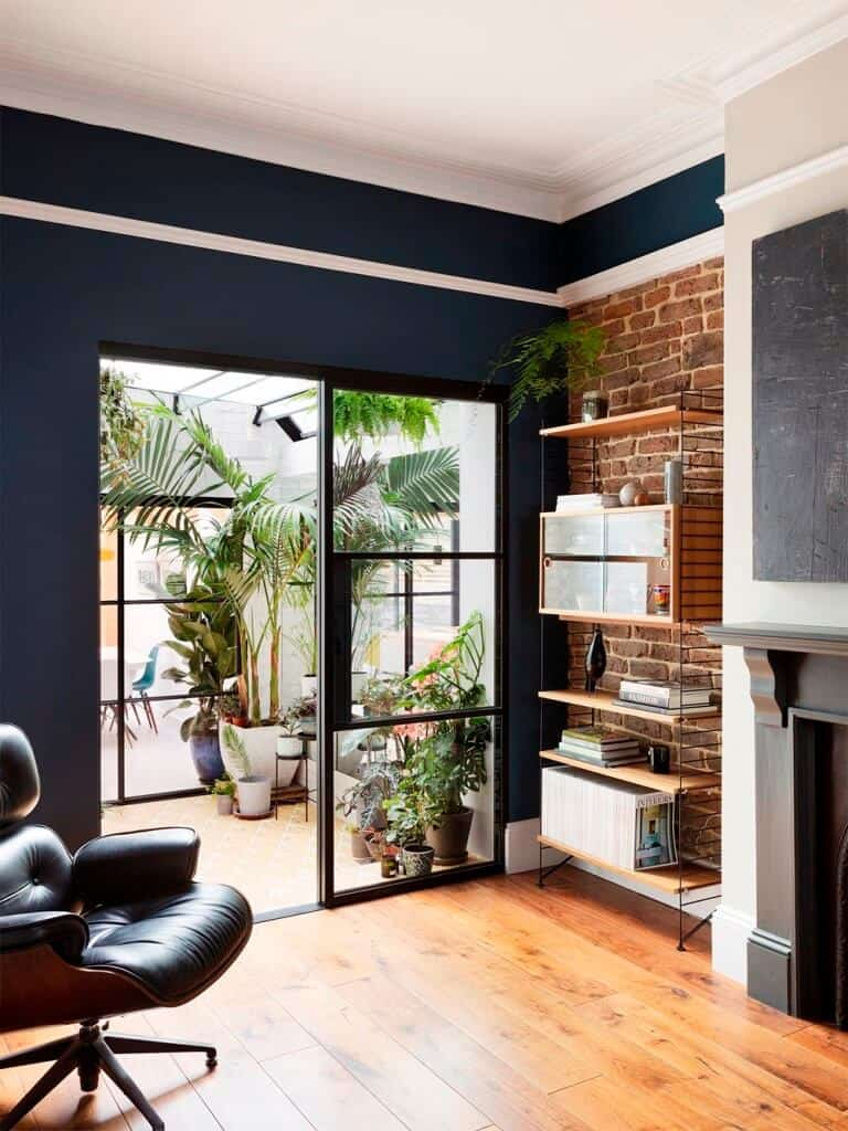 home design interior with sliding glass window with black metal frame