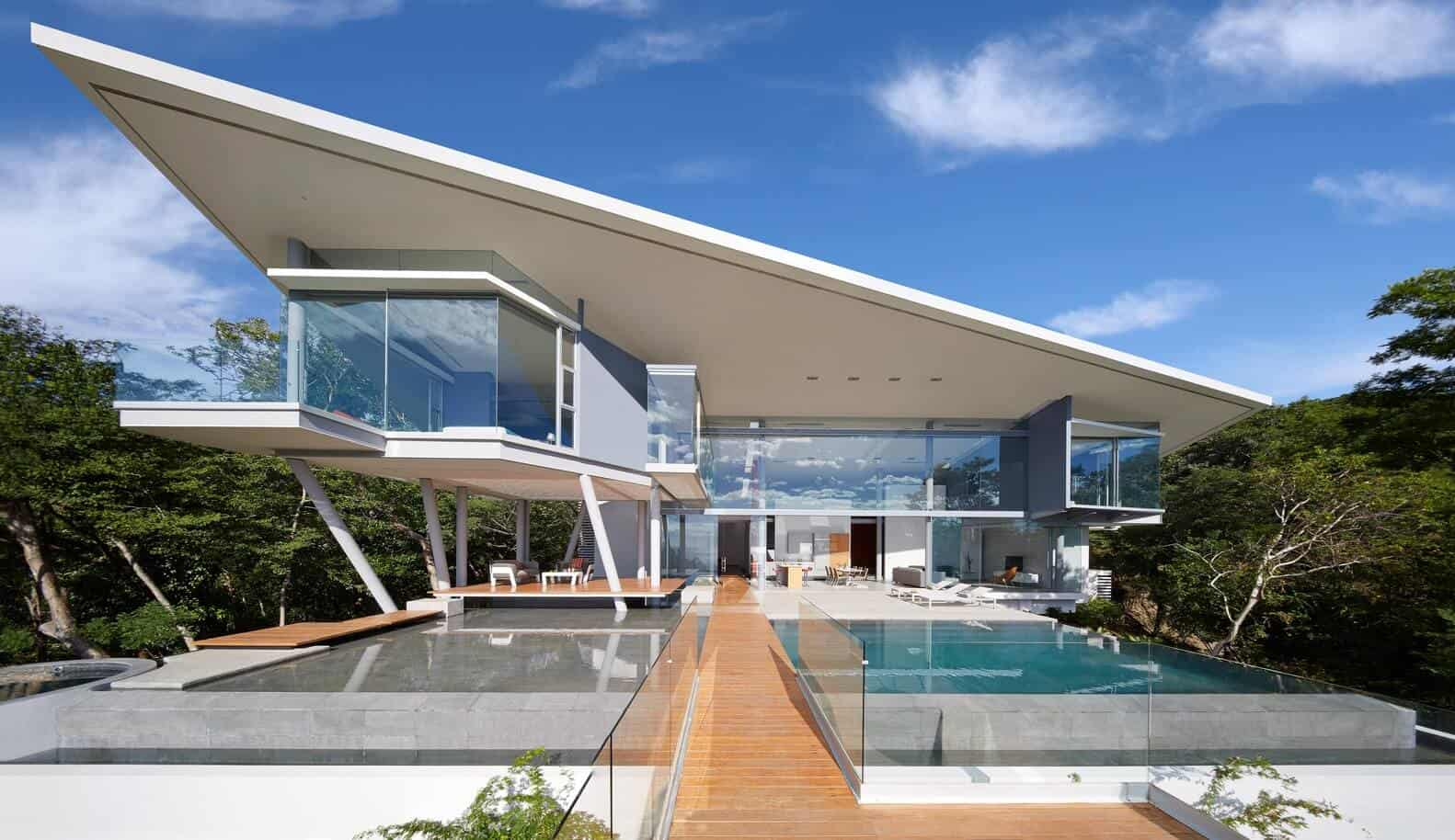 modern home design with a slant roof and glass walls
