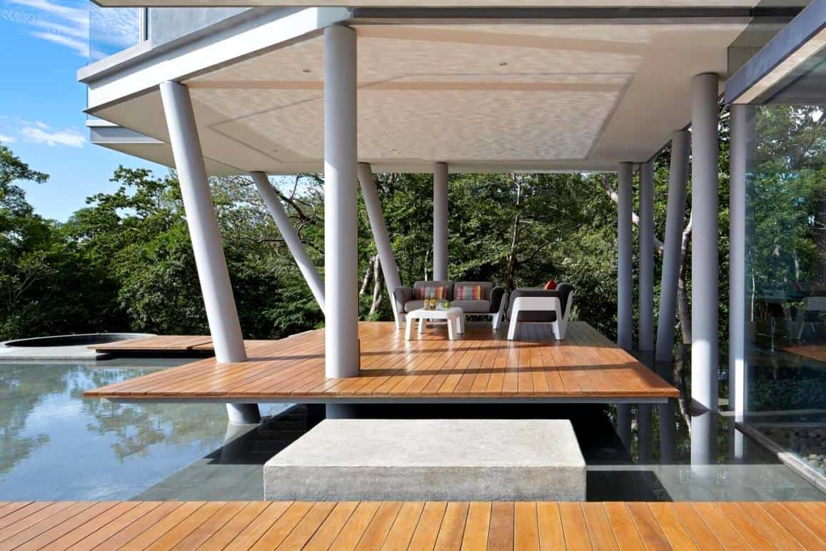 outdoor seating area with overhead panel and pool view