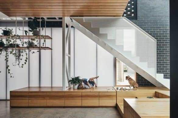 modern staircase beside black brick wall, home design interior with wooden ceiling and a wood seating deck