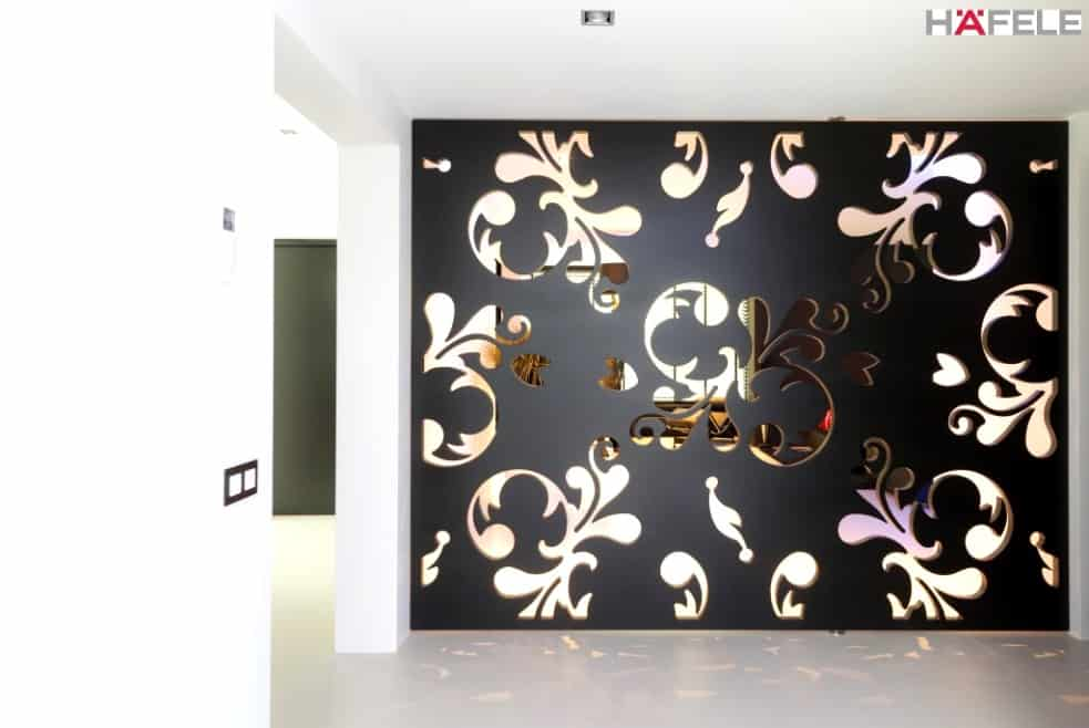 FritsJurgens Door Systems by Hafele, black partition system with gold detailing