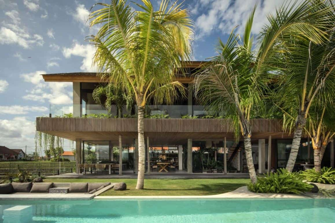 house design exterior with a swimming pool and tall palm trees