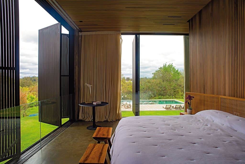 bedroom design with tall wooden windows