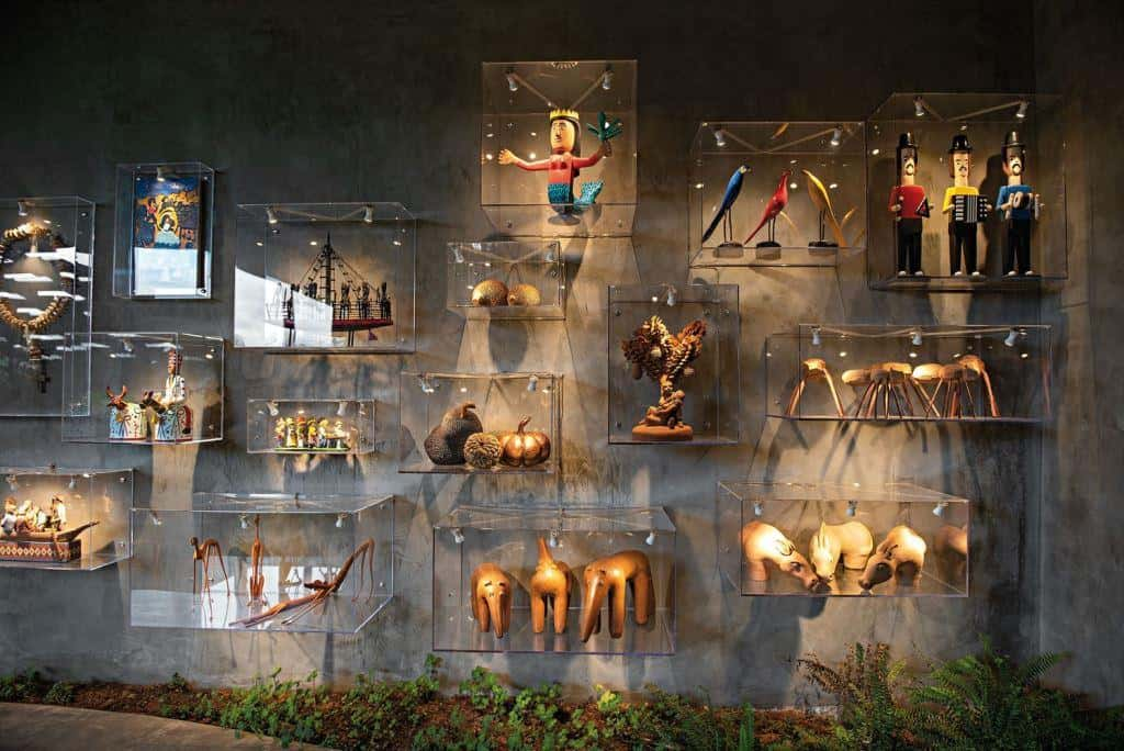 concrete wall with several showpieces in glass frames