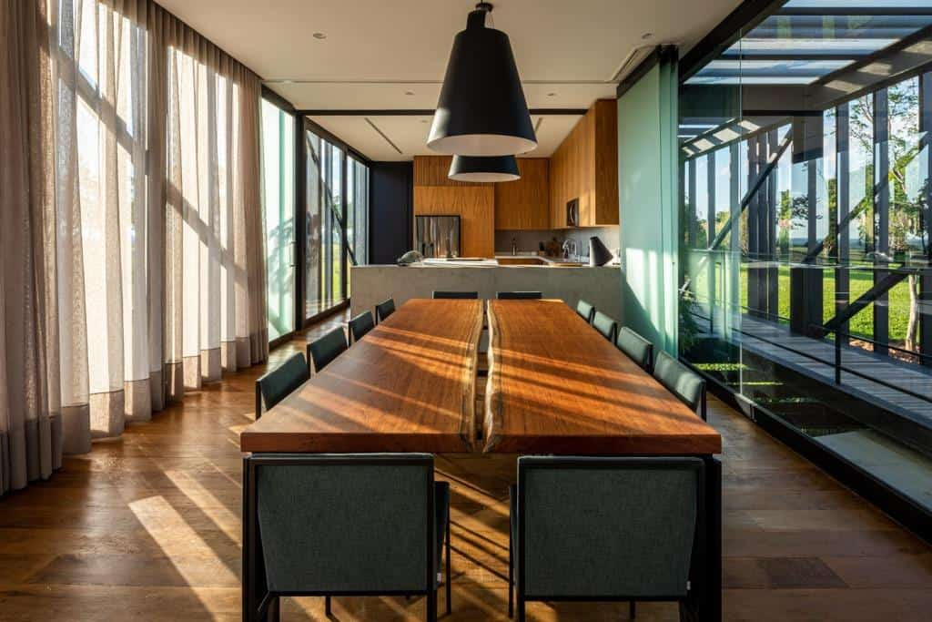 home design interior, dining room design with big glass windows and wooden flooring