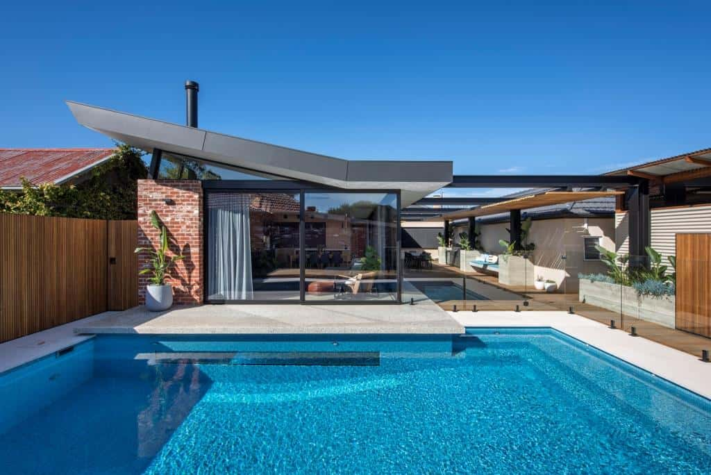 home design exterior with a swimming pool and huge glass window