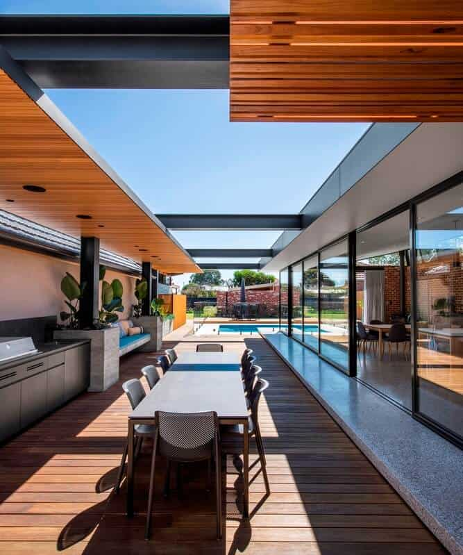 outdoors seating area in a home, home design exterior with a swimming pool and huge glass window