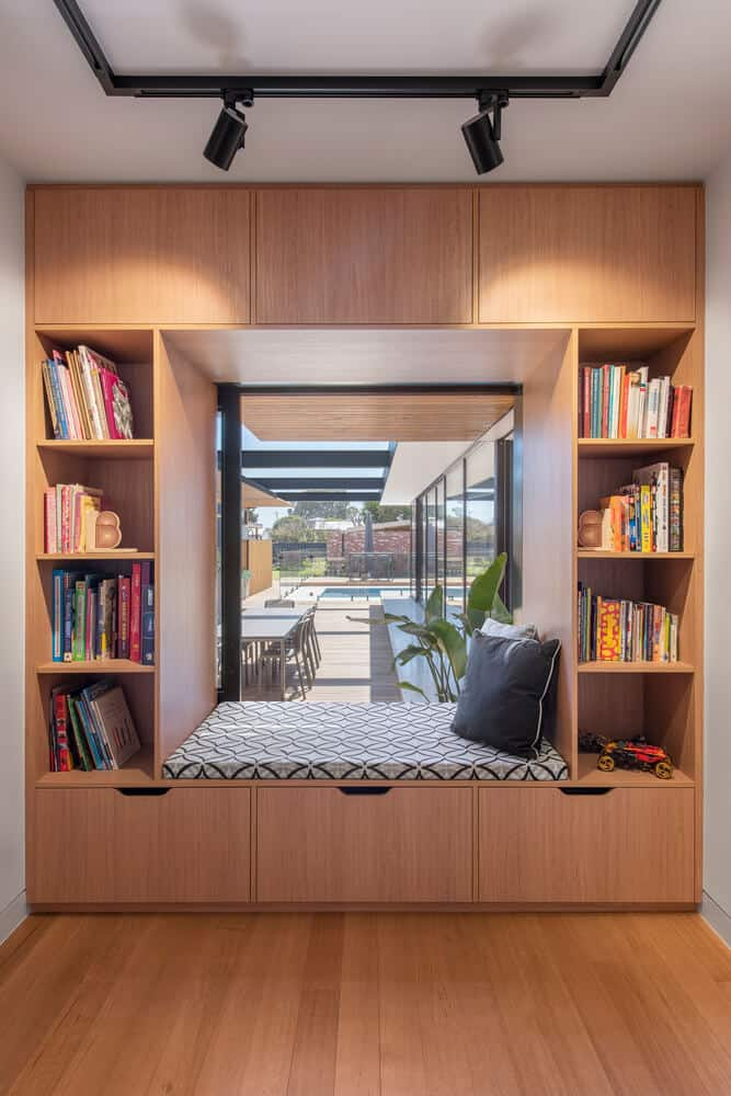 home design interior with wood bookshelf and a window