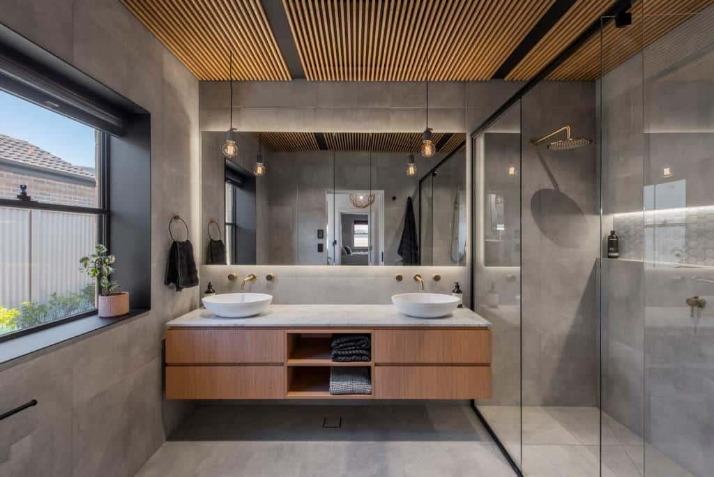 bathroom with grey wall and floor tiles
