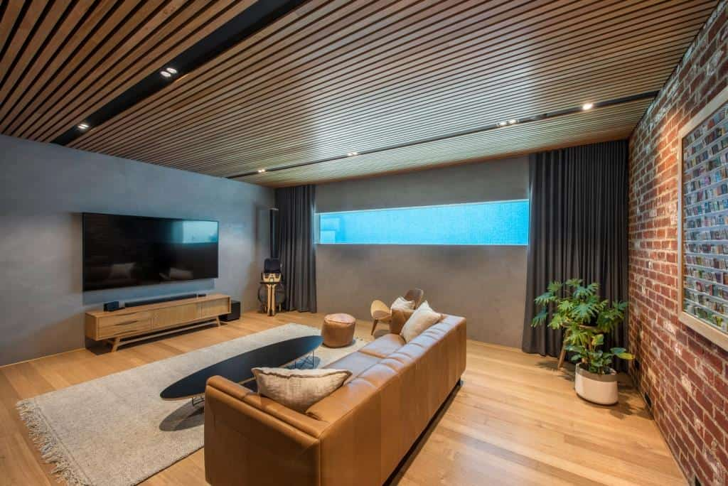 home designs interior having a faux brick wall and wooden plank ceiling