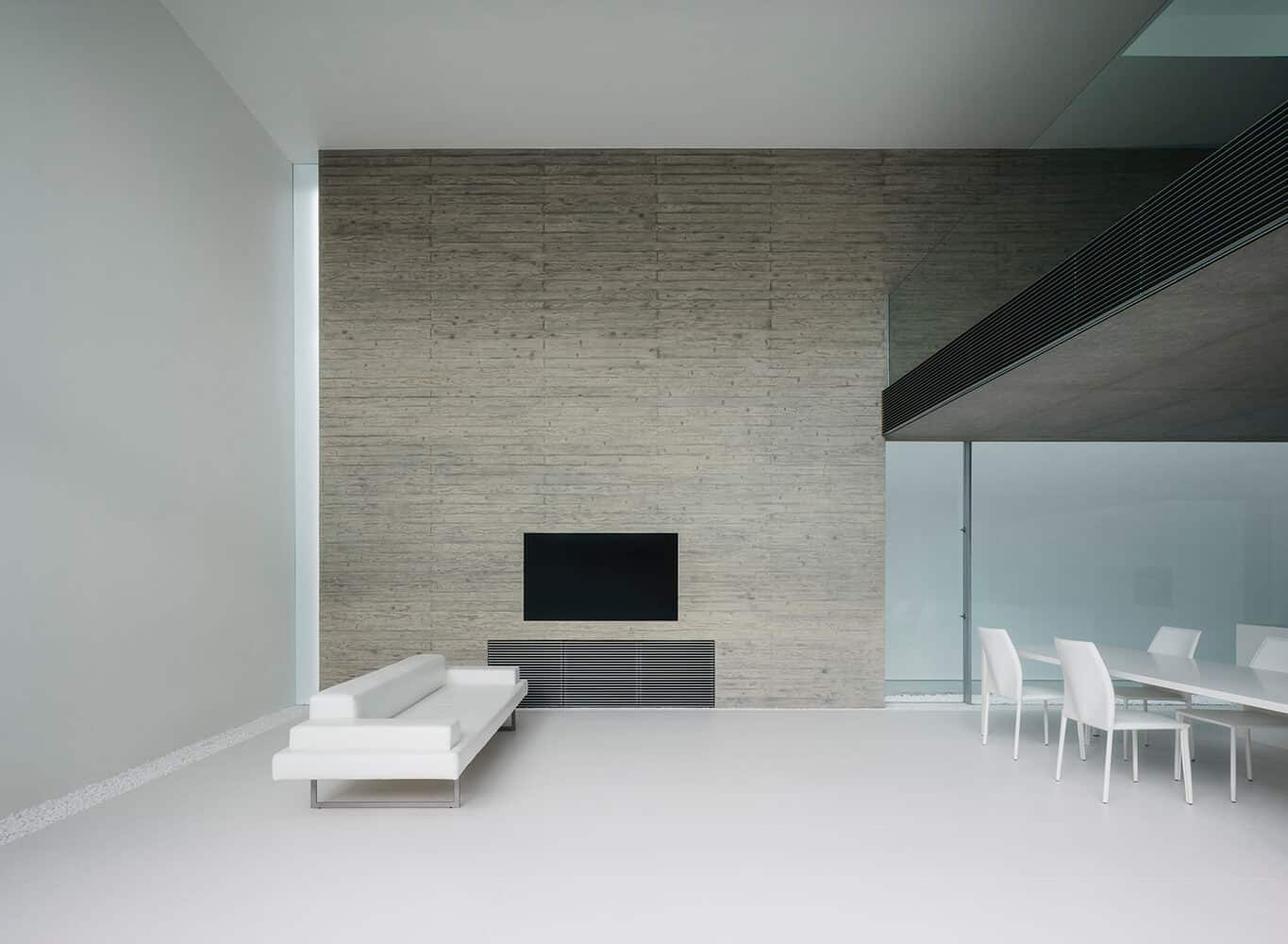 minimalistic living room with a white themed decor