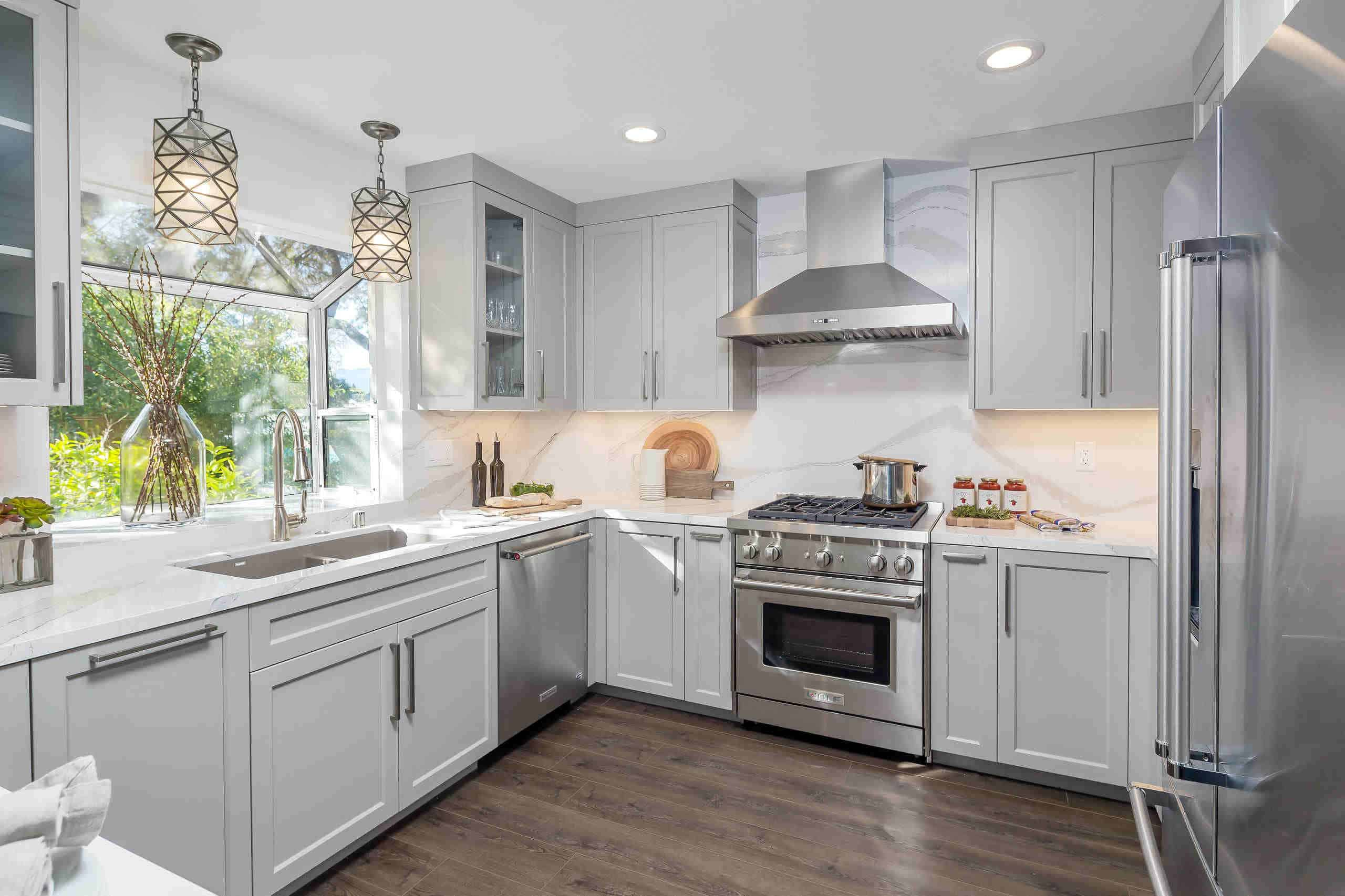 U-shaped kitchen with cabinets and light without island