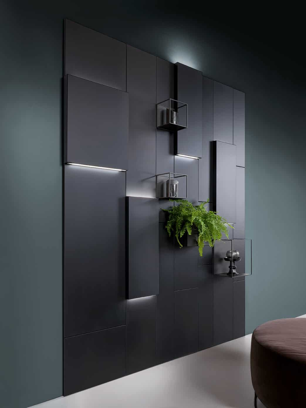 black pvc panels on a dark green background with concealed lights