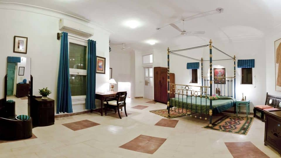 indian bedroom with metal poster bed