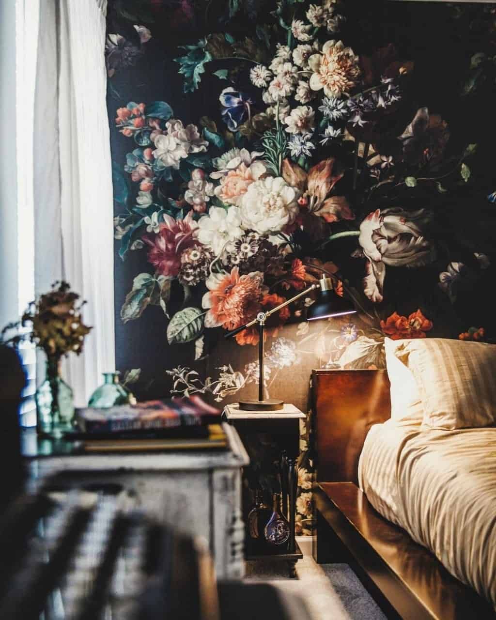 black floral wallpaper that creates a stunning fusion of themes