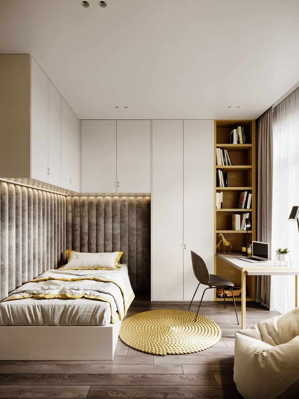 Small bedroom with velvet upholstered wall-mounted bed