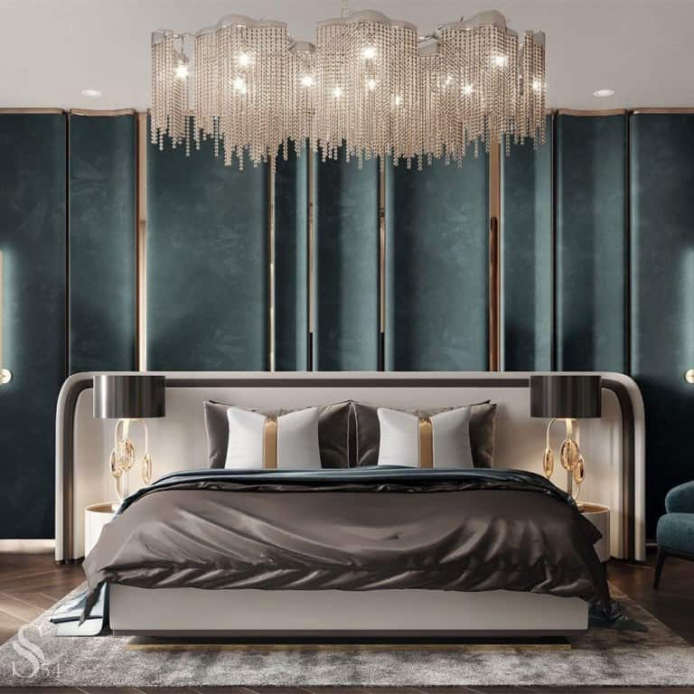 designer bed with gol accents on headboard and bedback wall