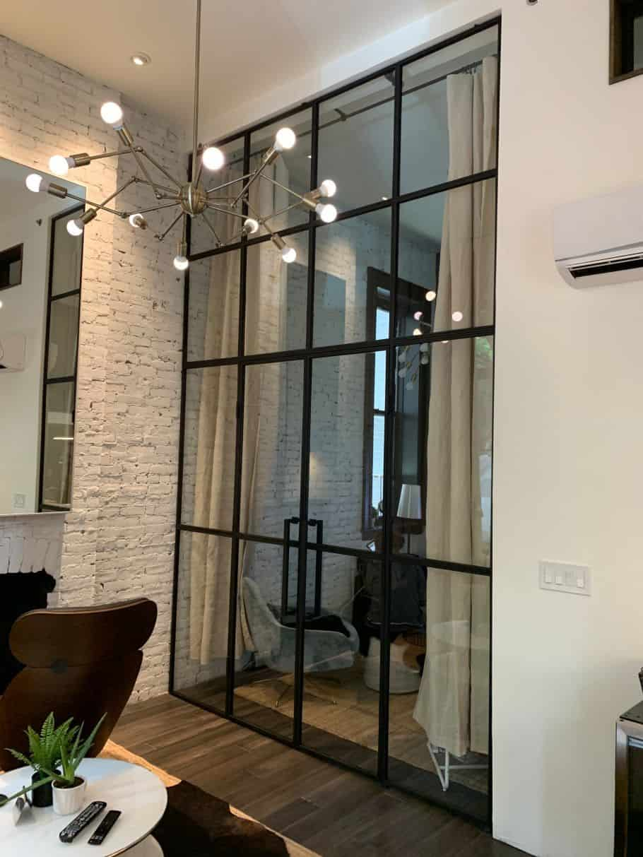glass partition wall design with black metal frames