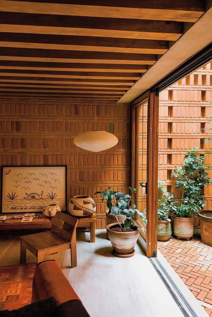 brick wall design for living room with wood furniture