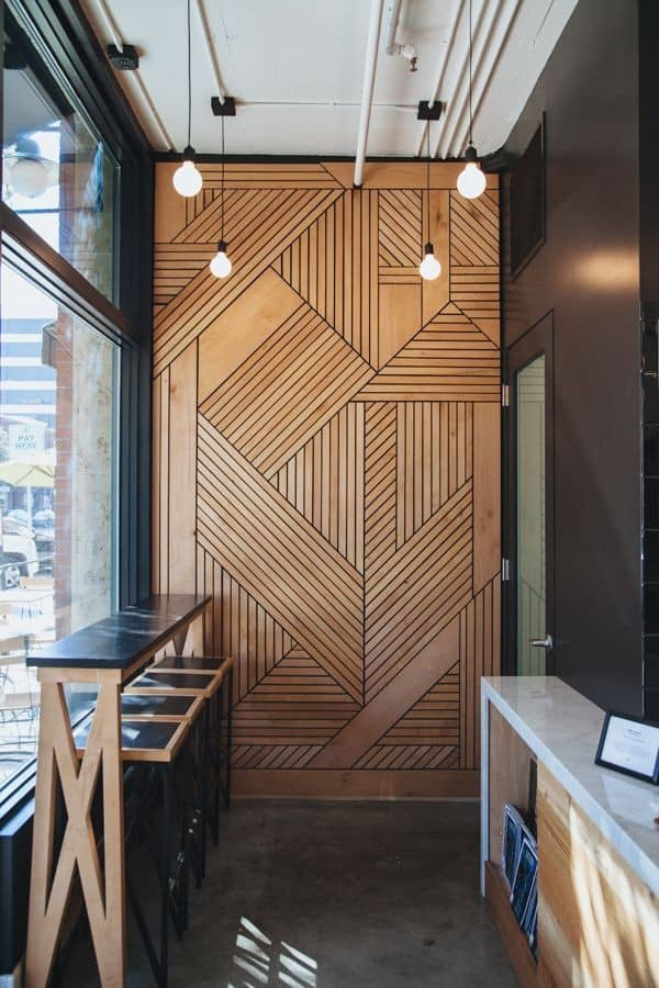 plywood wall design with carved lines