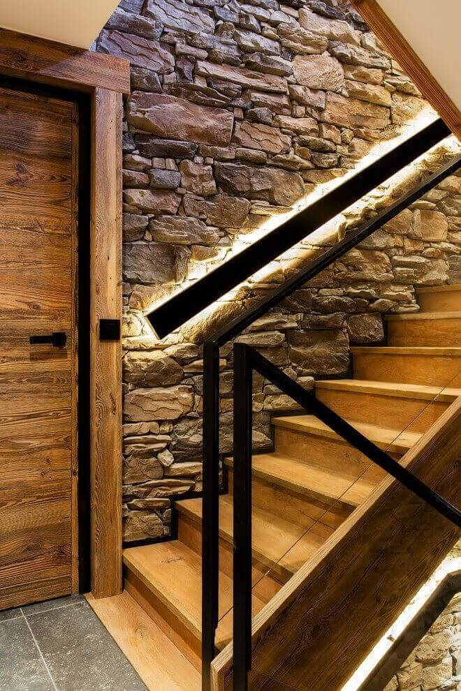 Mixed stone and wood wall by the stairway