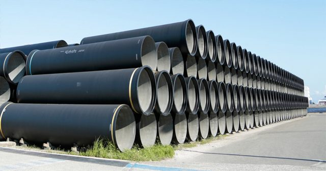 stack of cast iron pipes for pipeline