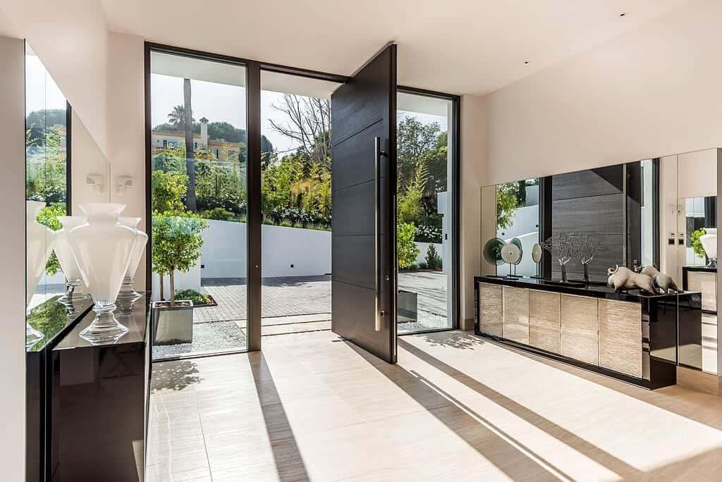 modern front door design, black colored steel pivot door