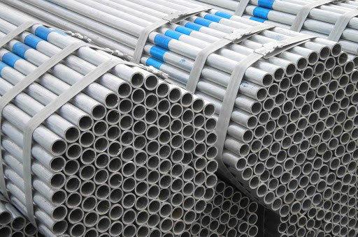 galvanized iron pipes stacked on top of each other
