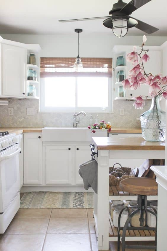 Contrast your white kitchen with a black fan with light.