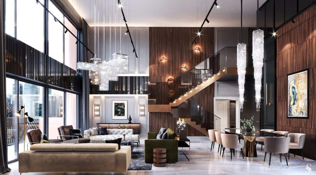 a well lit living room with tracklights, recessed downlights, chandeliers, wall sconces, and more