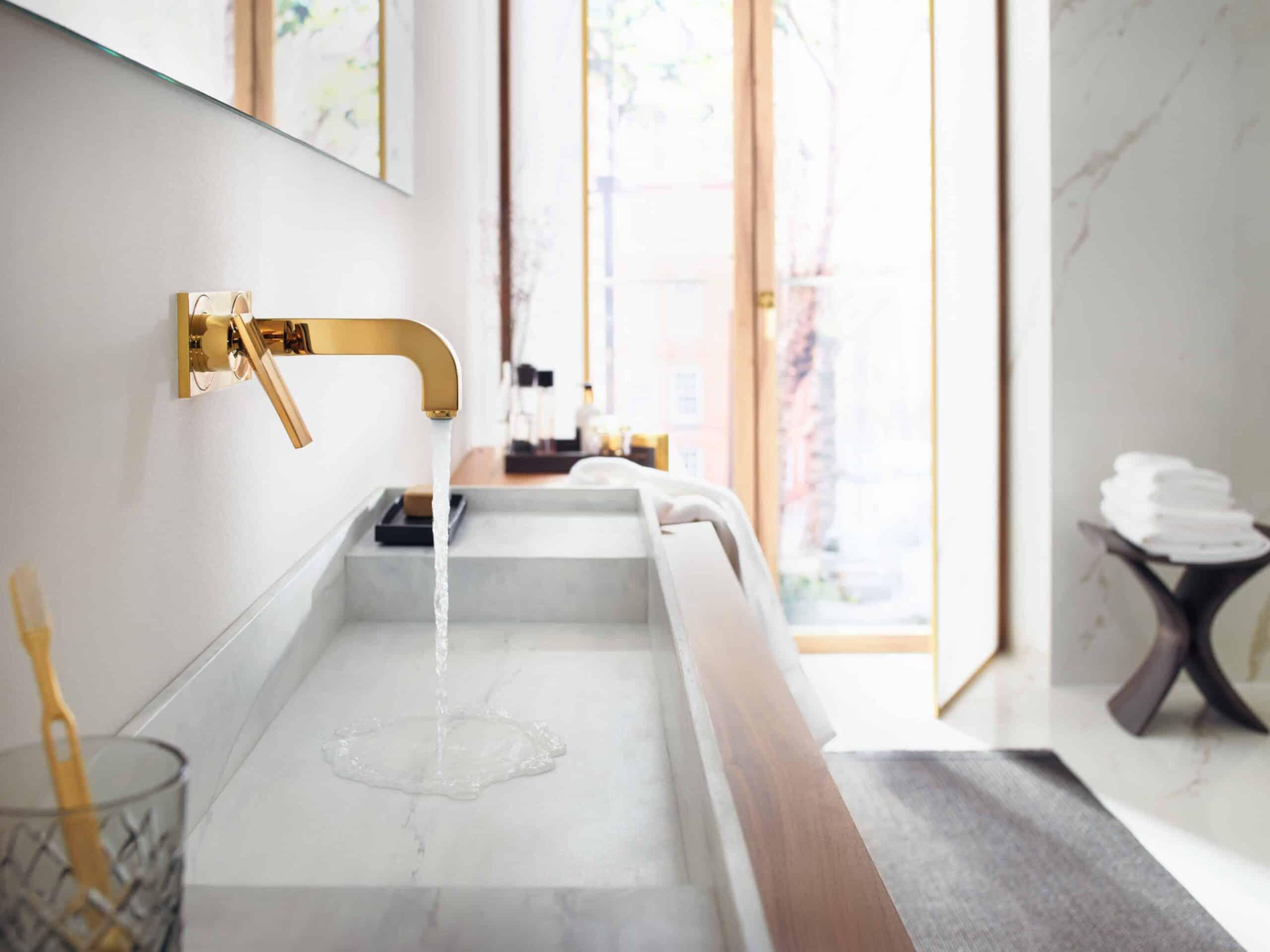 AXOR Citterio modern bathroom design collection, gold wall-mounted faucet