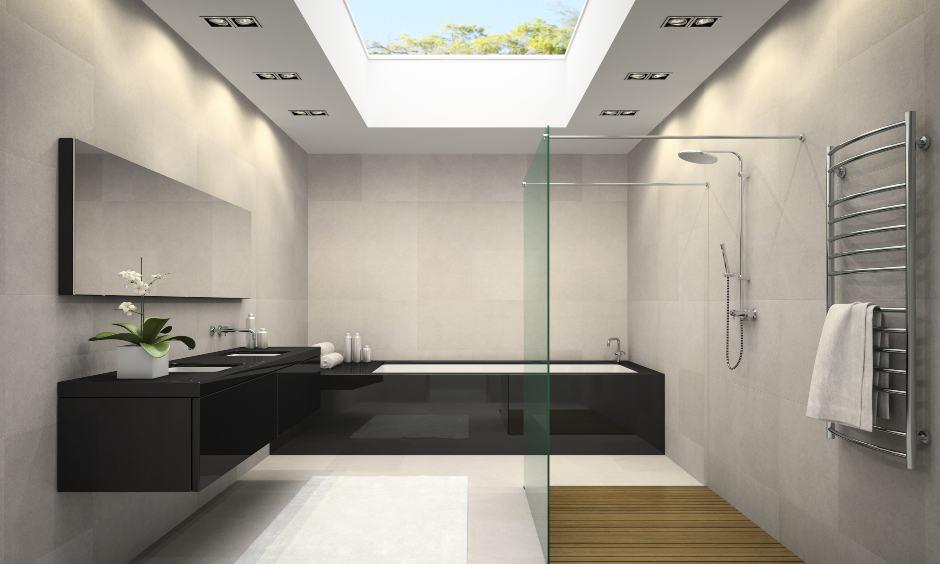 Backlit bathroom false ceiling design with floor for a minimalist look