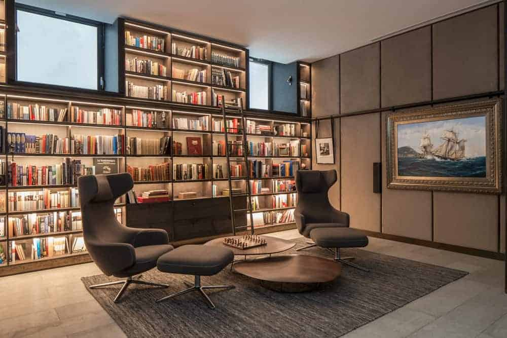 bookshelf on a living roomwall with concealed accent lights all over