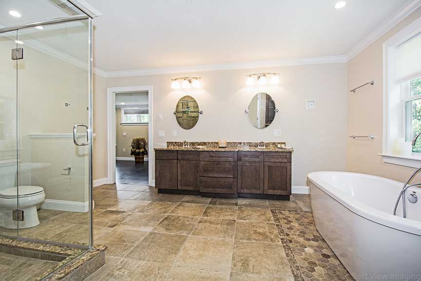 master bathroom ceiling design with tub and vanity
